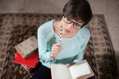Young student writing down notes Royalty Free Stock Photography