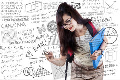Young student writing on whiteboard Stock Photo