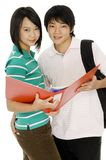 Young Students. Two young asian adults with file but looking at camera on white background stock photography