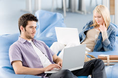 Young Students At High-school Working On Laptop Royalty Free Stock Images