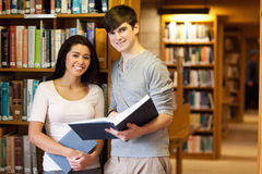 Young students with a book Royalty Free Stock Photo