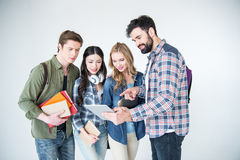 Young students in casual clothes holding books on white Royalty Free Stock Image