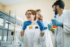 Young students of chemistry working in laboratory. Young students of chemistry working together in laboratory Stock Photos