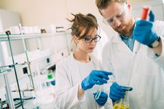 Young students of chemistry working in laboratory Stock Photo