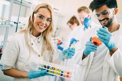 Young students of chemistry working in laboratory Stock Photos