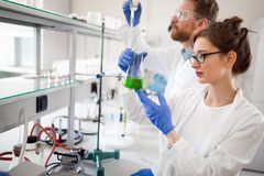 Young students of chemistry working in laboratory Stock Image