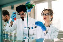 Young students of chemistry working in laboratory Royalty Free Stock Photos