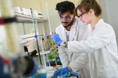 Young students of chemistry working in laboratory Royalty Free Stock Images