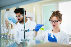 Young students of chemistry working in laboratory Royalty Free Stock Photography