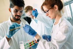 Young students of chemistry working in laboratory Stock Images
