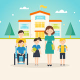 Young students, child with special needs and female teacher in front of school building with welcome sign. On it Stock Photos