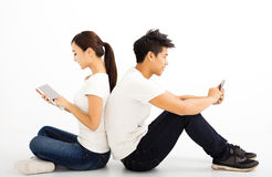 young students couple with  tablet and smart phone Royalty Free Stock Photo