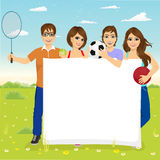Young students with different sports equipment Royalty Free Stock Photo
