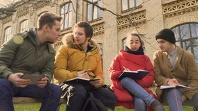 Young students discussing exams near the university stock video footage