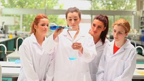 Young students doing an experiment Stock Image