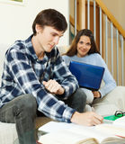 Young  students doing homework Stock Photos