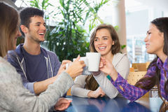 Young students having coffee together Royalty Free Stock Photo