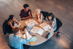Free Young Students In Cooperation With Their Academic Assignment Royalty Free Stock Photo - 79576615