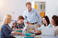 Young students involved in the process of studying Stock Photos