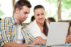 Young students with laptop Royalty Free Stock Image