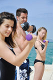 Young students lifting weights Royalty Free Stock Image