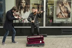 Street classic music duo. Young students of musical in Zagreb, Croatia perform in downtown earning their weekend pocket money Royalty Free Stock Photos