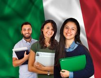 Young students over italian flag. Couple of young students with books over italian flag Stock Image