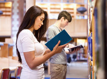 Young students reading a book while standing up Royalty Free Stock Photo
