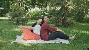 Young students relax in park after preparing to exams stock video footage
