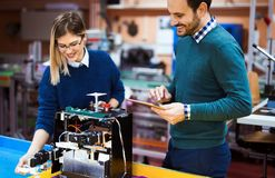 Young students of robotics working on project Royalty Free Stock Photo
