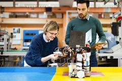 Young students of robotics working on project Stock Photography