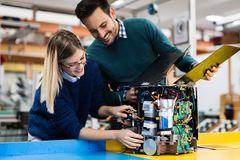 Young students of robotics working on project Stock Photos
