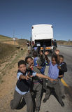 Young students and a school bus South Africa Royalty Free Stock Images