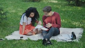 Young students preparing to exams in university in summer park stock footage