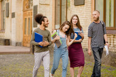 Young students spending leisure time walking together. Stock Images