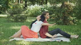 Young students stretches after preparing to exams, relax in park on grass stock video footage