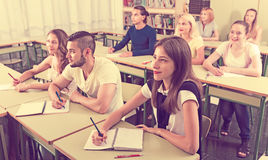 Young students studying in the classroom Stock Photo