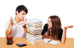 Young students studying  isolated over white. Two young students studying - isolated over white background Stock Photos