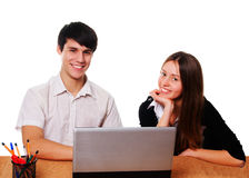 Young students studying  isolated over white Royalty Free Stock Photos