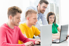 Young students studying at the lesson. Students at the informatics and programming lesson Royalty Free Stock Photography
