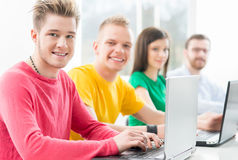 Young students studying at the lesson. Students at the informatics and programming lesson Stock Photos