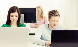 Young students studying at the lesson. Students at the informatics and programming lesson. Education concept. Hipster color Stock Photos