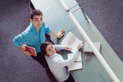 Young students studying in the library Royalty Free Stock Photo