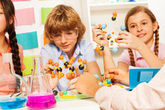 Young students studying molecular structure at lab Royalty Free Stock Photos