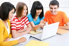Young students. Studying together with laptop Stock Photos