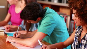 Young students studying together in the library stock footage