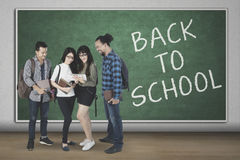 Young students with text of back to school Stock Image