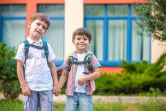 Young students, two sibling brothers, going to school. Royalty Free Stock Photo