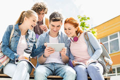 Young students using digital tablet at college campus Stock Photography