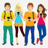 Young students using mobile phones Royalty Free Stock Photos